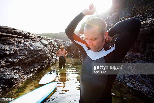 Two men in the water getting ready to surf.