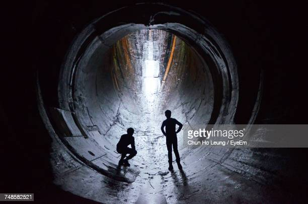 Two Men In Tunnel