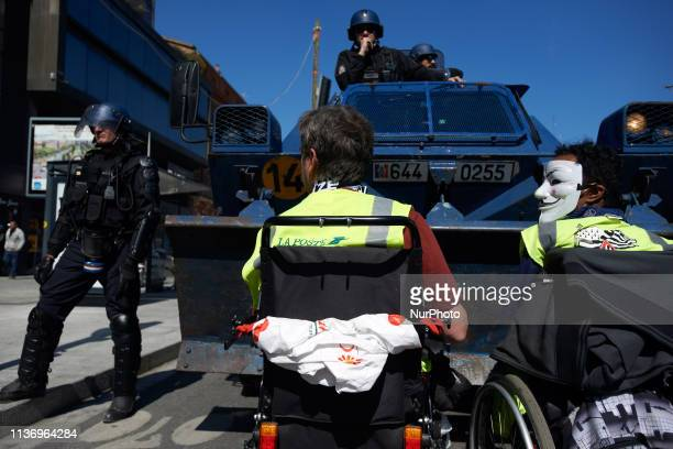 Two men in whellchair stay in front of armored vehicles from the Gendarmerie Mobile The 'Gilets jaunes' protest for the 22nd week in a Row For the...