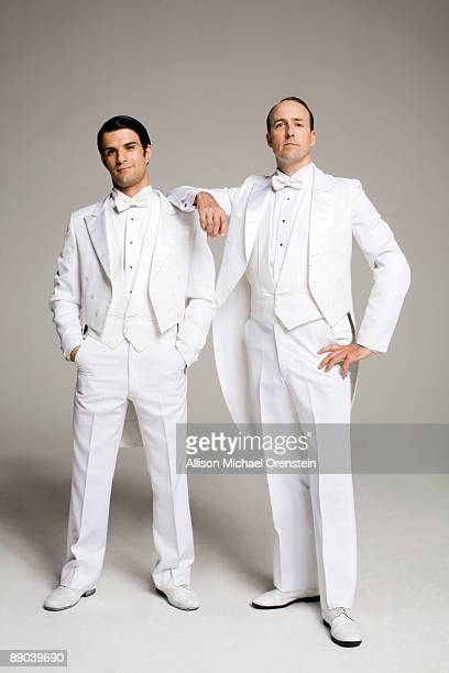 Two men in white tuxedos standing