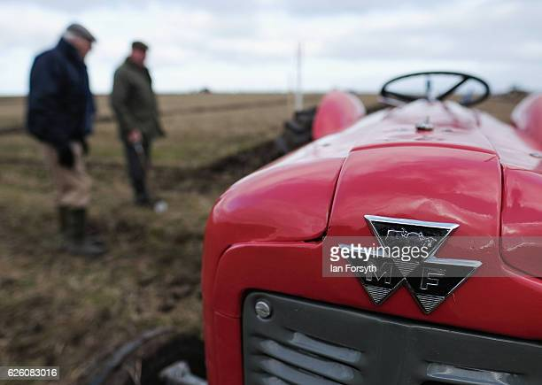 Two men inspect the furrows during the annual ploughing match on November 27, 2016 in Staithes, United Kingdom. The event which is held each year in...