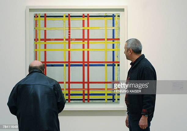Two men inspect the painting 'New York City 1 ' by Dutch artist Piet Mondrian shown in the exhibition 'Piet Mondrian Vom Abbild zum Bild' 12 December...