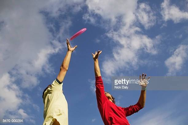 Two Men Jumping for Frisbee