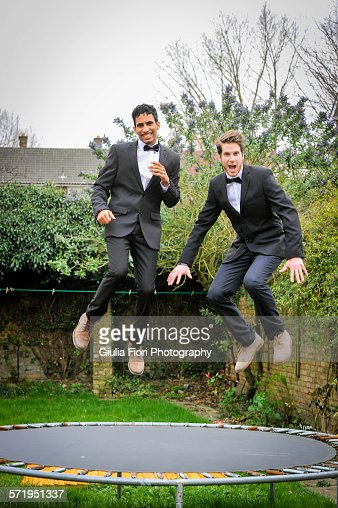 Two men jumping on a trampoline