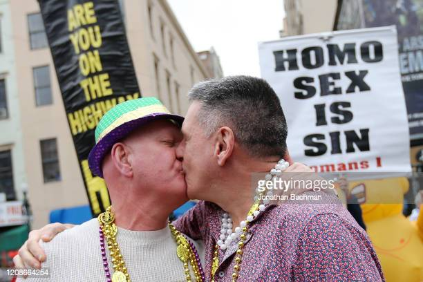 Two men kiss in front of religious protesters during Fat Tuesday celebrations on February 25 2020 in New Orleans Louisiana Fat Tuesday or Mardi Gras...