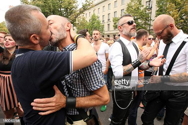 Two men kiss in front of the Russian Embassy as part of the 'To Russia With Love' Global KissIn on September 8 2013 in Berlin Germany The event was...