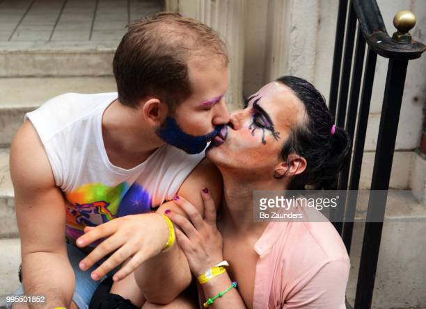 Two men kissing at the annual Gay Pride Parade in NYC.
