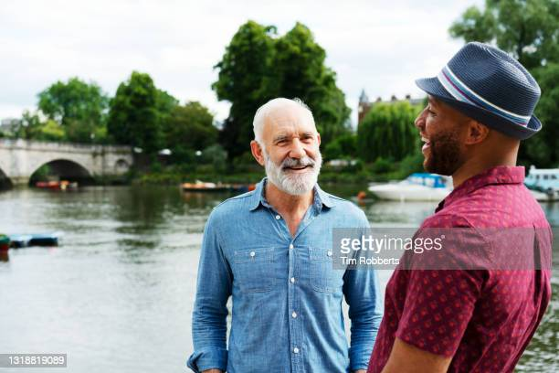 two men laughing with each other - mature adult stock pictures, royalty-free photos & images