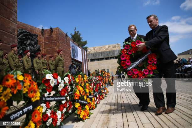 Two men lay a wreath during a ceremony marking the annual Holocaust Remembrance Day at the Yad Vashem Holocaust memorial in Jerusalem Israel April 24...