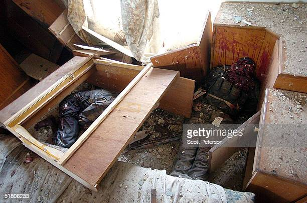 Two men lay dead after a battle with US Marines in a house that left one marine dead and three wounded November 29 2004 in Fallujah Iraq US...