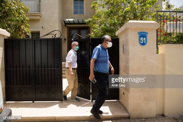Two men leave the house of China's Ambassador to Israel Du Wei, after he was found dead in his house on May 17, 2020 in Herzliya, Israel. Du Wei was...