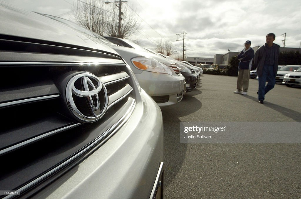 Two Men Look At Brand New Toyota Corollas On Display At Melody Toyota  January 26 2004