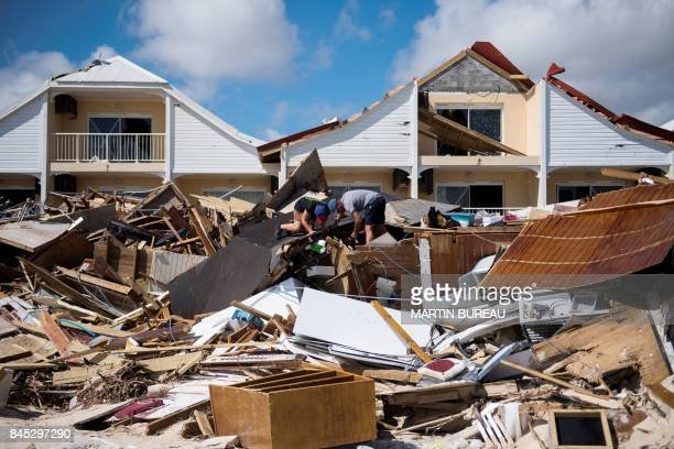 TOPSHOT Two men look for belongings in the rubbles of their restaurant on September 10 2017 on a beach in Orient Bay on the French Carribean island...