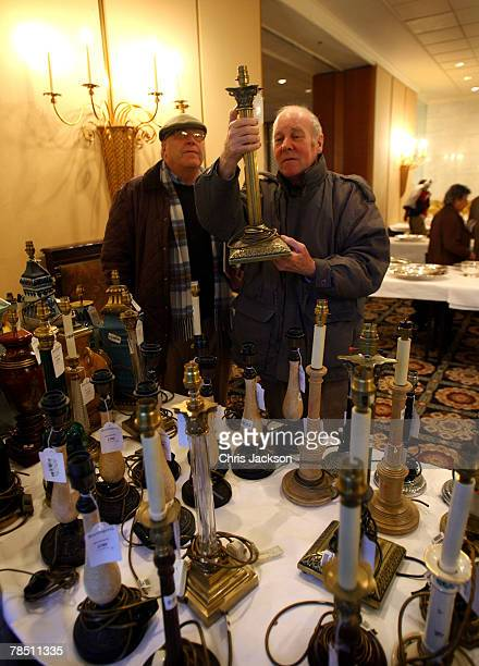 Two men look through some of the lots for auction at the Savoy Sale on December 17, 2007 in London, England.Three thousand items of furniture from...