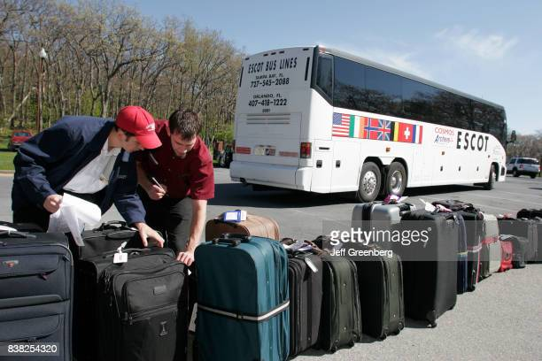 Two men looking at luggage from a tour bus at Skyland Resort.