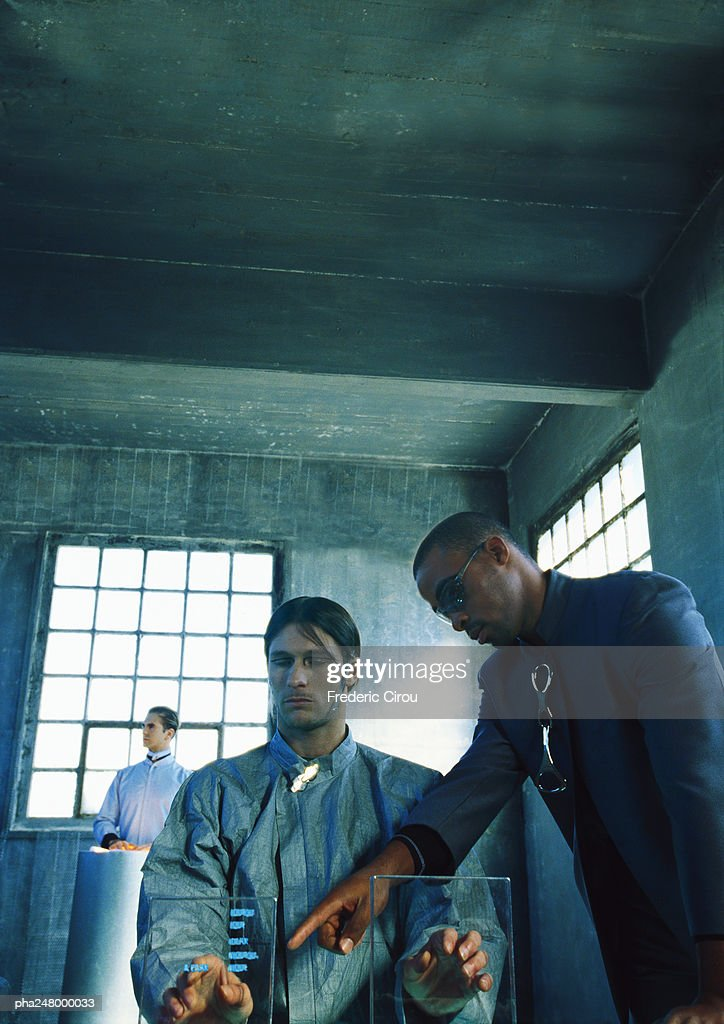 Two men looking at transparent screen : Stockfoto