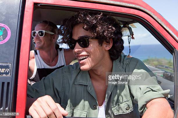 Two men looking out of open car window on vacation