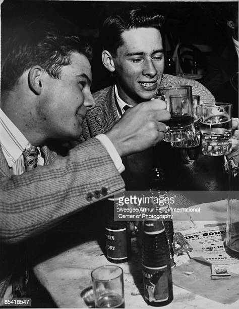 Two men make a toast before going to see Art Hodes and his Blue Note jazz men New York ca1939 Photo by Weegee/International Center of...