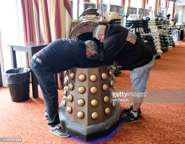Two men make adjustments to their Dalek at a display on the first day of the Scarborough Sci-Fi weekend at the seafront Spa Complex on April 06, 2019...