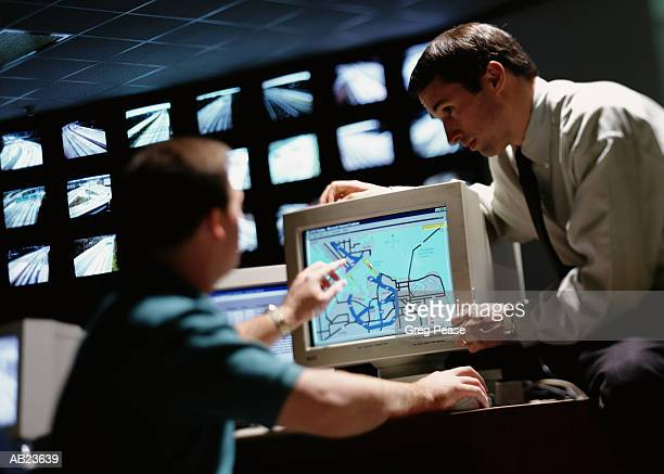 Two men monitoring highway traffic in control center