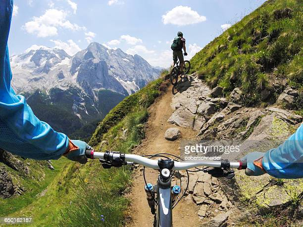 Two men mountain biking, Dolomites, Italy