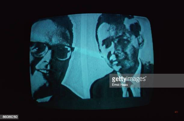 Two men on a television screen broadcast May 1977