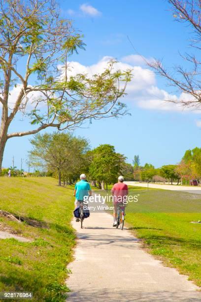 Two men on bikes enjoying a leisurely ride on bike path