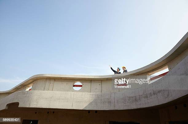 two men on construction site looking up - high up stock pictures, royalty-free photos & images