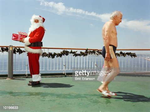 Two Men On Deck Of Cruise Ship One In Santa Claus Costume Stock - Cruise ship costume
