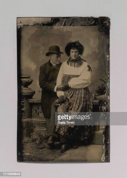 Two Men, One Dressed in Women's Attire, Holding Hands, 1870s-80s, Tintype, Image: 8.6 x 5.2 cm , irregular, Photographs, Unknown .