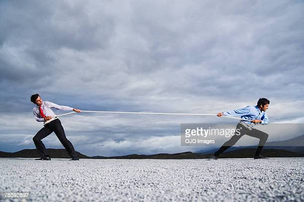 two men outdoors in tug of war - contest stock pictures, royalty-free photos & images