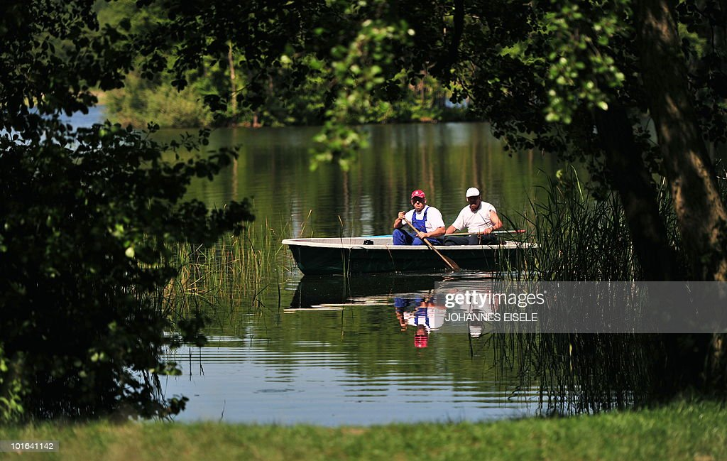 Two men paddle on a lake near lindow some 100 kilometers north of Berlin on June 5, 2010 in Berlin, Germany. Spring brought warm and sunny weather to wide parts of the country.