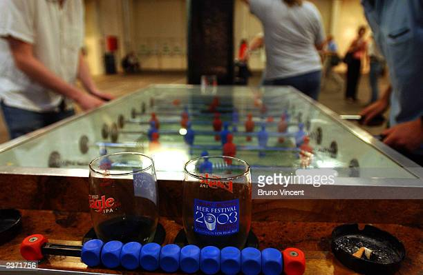 Two men play table football at the Great British Beer Festival at the Olympia Exhibition Center August 5, 2003 in London, England.