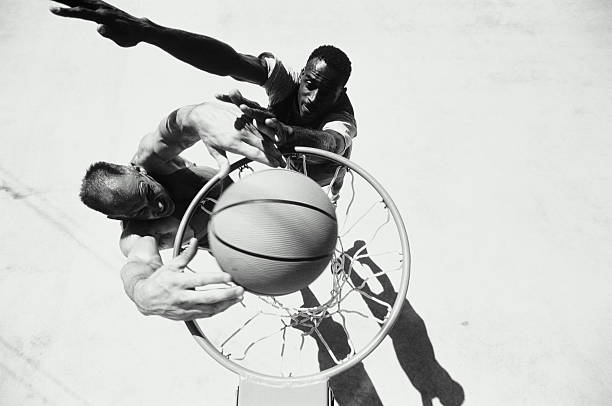 Two men playing basketball,  elevated view (B&W)
