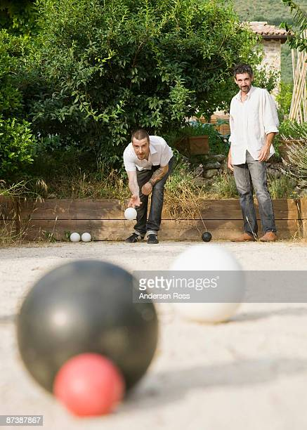 Two men playing bocce ball