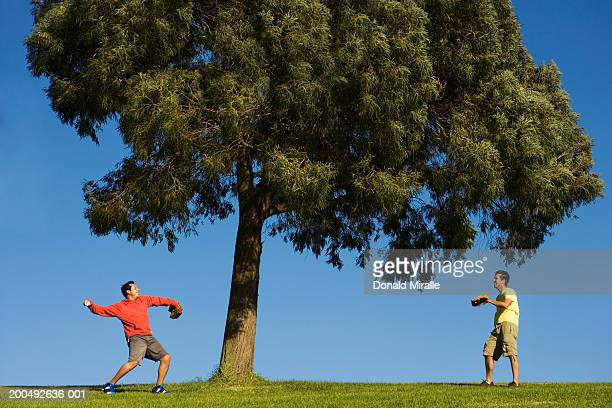 Two men playing catch baseball
