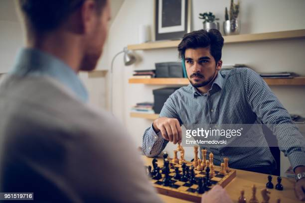 two men playing chess - chess stock pictures, royalty-free photos & images