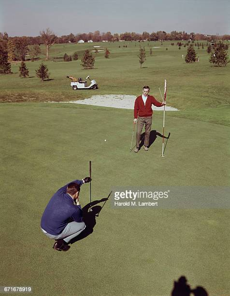 two men playing golf at golf course  - number of people stock pictures, royalty-free photos & images