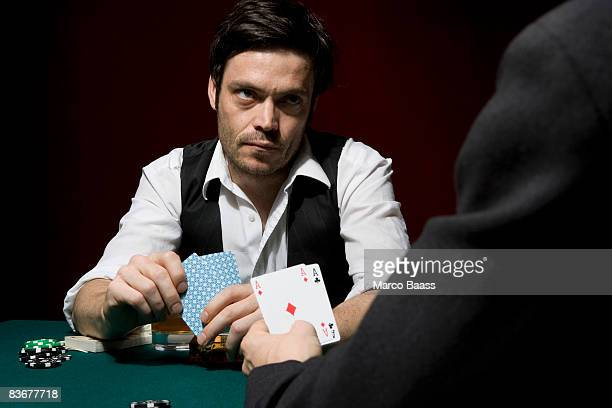 Two men playing poker at a high stakes game