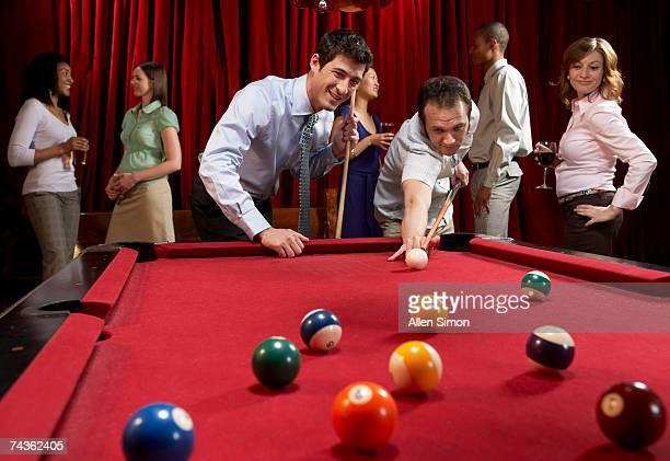 Two men playing pool at pub