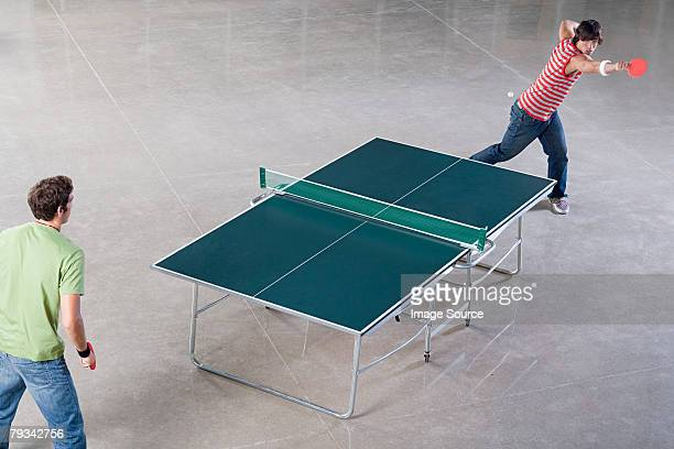 two men playing table tennis - table tennis stock pictures, royalty-free photos & images