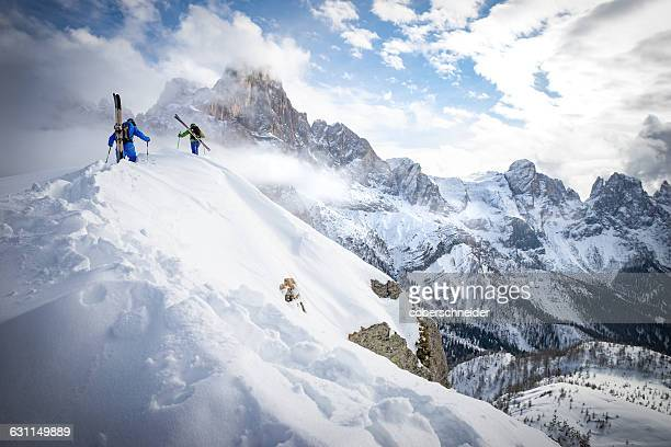 Two men Powder Skiing in Dolomites, Italy