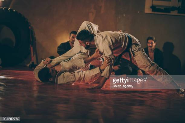 two men practicing martial arts - brazilian culture stock pictures, royalty-free photos & images