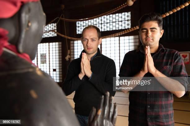 Two men praying at temple