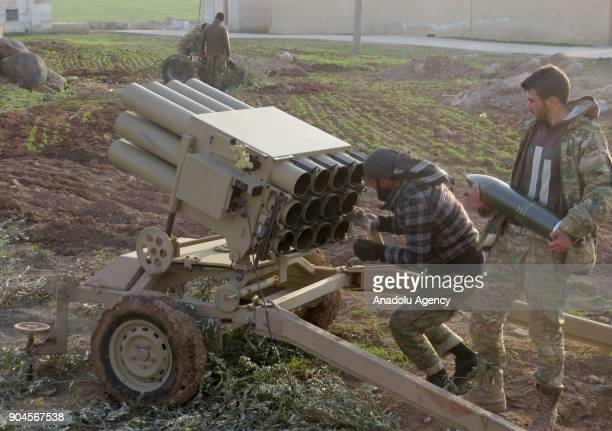 Two men prepare a multibarrel rocket launcher within the clashes between armed opposition group Tahrir alSham and Assad Regime forces around the Abu...