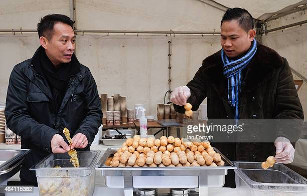 Two men prepare food at a stall as the Chinese community come together to welcome in the Chinese New Year on February 22 2015 in Newcastle upon Tyne...