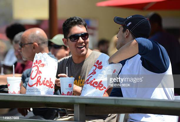 Two men prepare to have lunch on the patio of the ChickfilA in Hollywood California August 1 2012 Thousands of Americans turned out Wednesday to...