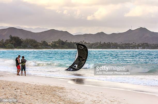 Two Men Preparing their Sail for Kite Surfing in the Teal Waters of Kailua Beach with the Mokapu Peninsula in the Distance