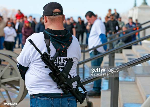 Two men provide security with their firearms at a protest to new gun legislation at the Utah State Capitol in Salt Lake City Utah on February 8 2020...