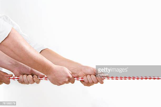 Two men pulling a rope